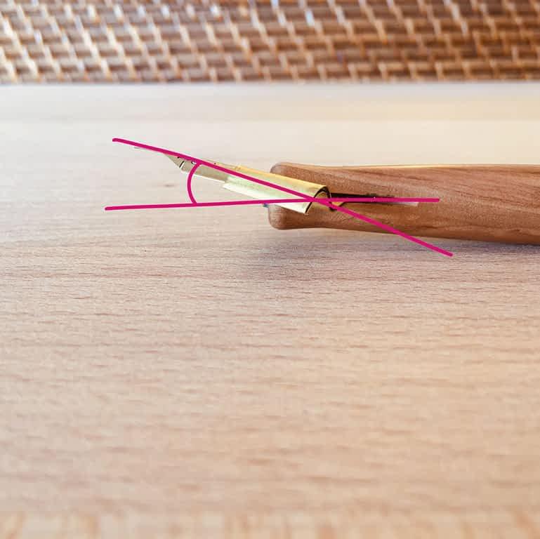 Photo of adjusting the pitch of an oblique nib holder flange